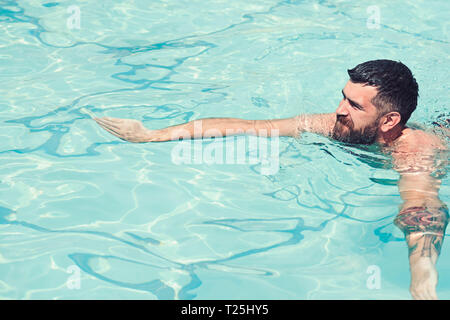 Summer vacation and travel to ocean. bearded man swimming in blue water. Relax in spa swimming pool, refreshment and skincare. Maldives or Miami beach - Stock Photo