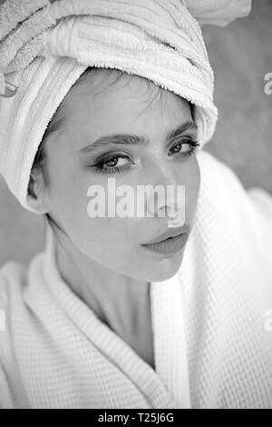 Her haircare routine. Beauty routine and hygiene care. Pretty woman wear bath towel on head. Young woman in bathing gown. Skincare model after spa - Stock Photo