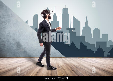 bearded man in VR glasses walking in an empty room, going into    a non-existent cartoon virtual city, concept of new technologies and virtual reality - Stock Photo