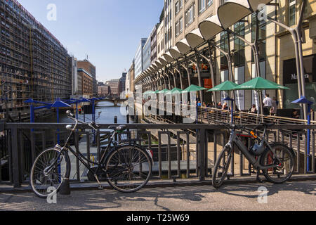 Hamburg, Germany - September 04, 2018: Hamburg cityscape. Bicycles parked on bridge above water aganst. Germany - Stock Photo