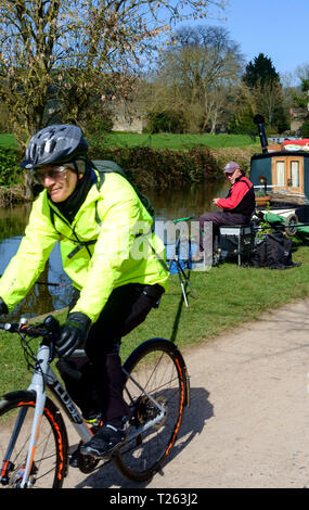 Along the Kennet and Avon canal at Bathampton in the the spring Bath Somerset UK Fishing and Cycling - Stock Photo