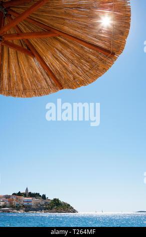 Croatia, Dalmatia, Primosten, Adria, beach umbrella - Stock Photo