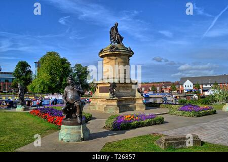 William Shakespeare (centre) and Falstaff (foreground) Statues in town centre gardens, Stratford-upon-Avon, Warwickshire, England, UK - Stock Photo