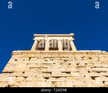 View from below of Temple of Athena Nike (Athena the Victory) in Acropolis of Athens, Greece - Stock Photo