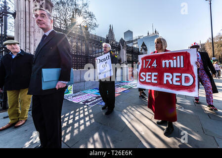 Conservative MP Jacob Rees-Mogg arriving at the Palace of Westminster, London, UK. 29th March 2019, the date that should have been Brexit. Protester - Stock Photo