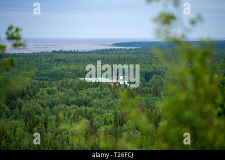 SOLOVKI, REPUBLIC OF KARELIA, RUSSIA - JUNE 27, 2018: View of the Holy Ascension monastery of the Solovki monastery, Savvatyevo from the top of the Se - Stock Photo