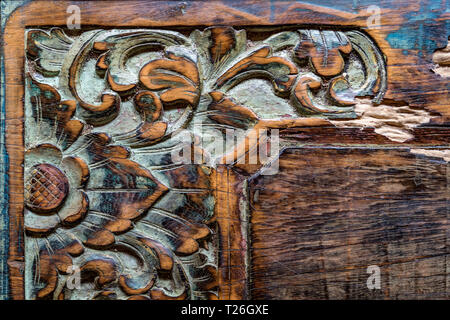 Vintage Balinese traditional wooden carving ornament background - Stock Photo