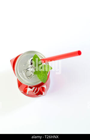 Crumpled aluminum can and drinking straw on white background - Stock Photo