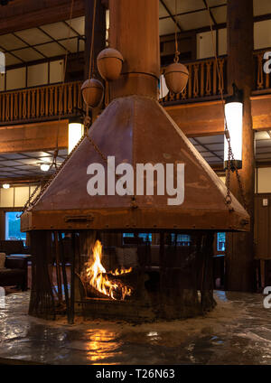 Many Glacier, United States: June 29, 2018: Fire Place With Metal Cover