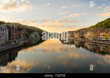 Dinant is a city in the Belgian region of Wallonia, located on the banks of the Meuse and surrounded by steep cliffs. - Stock Photo