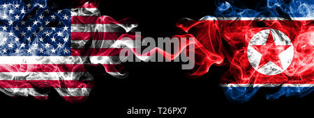 United States of America vs North Korea, Korean smoky mystic flags placed side by side. Thick colored silky smoke flags of America and North Korea, Ko - Stock Photo