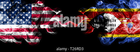 United States of America vs Swaziland, Swazi smoky mystic flags placed side by side. Thick colored silky smoke flags of America and Swaziland, Swazi. - Stock Photo