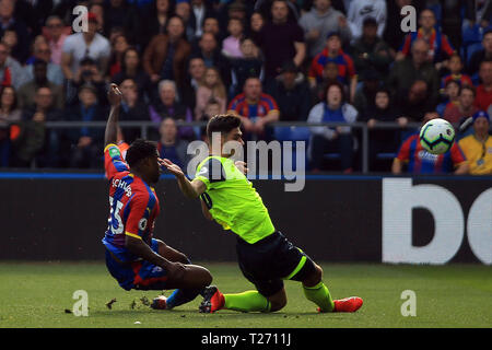 London, UK. 30th March 2019. Jeffrey Schlupp of Crystal Palace (L) takes a shot at goal. Premier League match, Crystal Palace v Huddersfield Town at Selhurst Park in London on Saturday 30th March 2019.  this image may only be used for Editorial purposes. Editorial use only, license required for commercial use. No use in betting, games or a single club/league/player publications. pic by Steffan Bowen/Andrew Orchard sports photography/Alamy Live news - Stock Photo