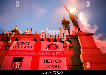London, UK. 30th March, 2019. Travelling Sunderland supporters on the evening before their EFL Trophy final against Portsmouth at Wembley take over Trafalgar Square. Penelope Barritt/Alamy Live News - Stock Photo