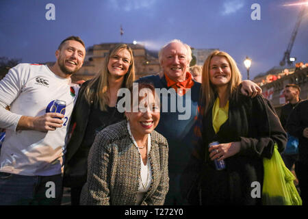 London, UK. 30th March, 2019. Mayor of Sunderland Lynda Scanlan, center, with member of Sunderland's 1973 FA Cup winning team, Micky Horswill, 2nd right, Travelling Sunderland supporters on the evening before their EFL Trophy final against Portsmouth at Wembley take over Trafalgar Square. Penelope Barritt/Alamy Live News - Stock Photo