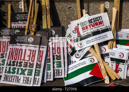 London, UK. 30 March, 2019. Placards at the rally, Exist Resist! Return! Palestinians and supporters gathered outside of the Israeli Embassy in London to mark the beginning of Nakba and to call on the global community to hold Israel to account for their violation of human rights and International law. David Rowe/ Alamy Live News. - Stock Photo