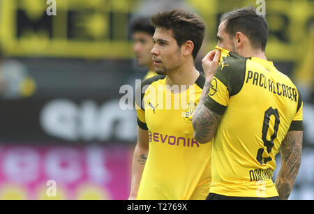 Dortmund, Germany. 30th March 2019. Dortmund's Spanish forward Paco Alcacer and Raphael Guerreiro are seen in action during the Bundesliga match between Borussia Dortmund and VfL Wolfsburg at the Signal Iduna Park. ( Final score; Borussia Dortmund 2:0 VfL Wolfsburg ) Credit: SOPA Images Limited/Alamy Live News - Stock Photo