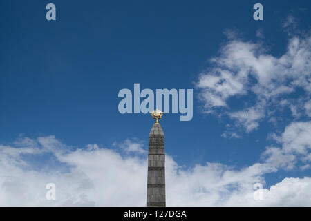 The mighty Victory Obelisk Monument in Independence Square in Minsk, Belarus. - Stock Photo