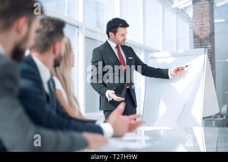 project Manager makes a presentation for the business team. - Stock Photo