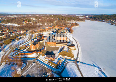 A view from the heights of the ancient fortress of the Hameenlinna city on a March morning (aerial survey). Finland - Stock Photo