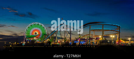 DECEMBER 20, 2018 - SANTA MONICA, CALIFORNIA, USA - Santa Monica Pier with Ferris Wheel and neon lights at sunset, Santa Monica, CA - Stock Photo