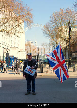 Pro Brexit March 29/3/2019 Protester waving a union jack flag outside Downing Street, Westminster, Central London, UK - Stock Photo