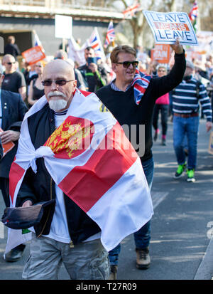 Pro Brexit March 29/3/2019 Protester wearing a St George's flag outside Houses of Parliament, Westminster, Central London, UK - Stock Photo