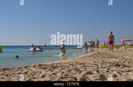 A low angle view of a lazy day on the Grecian - Glyki Nero Beach in Ayia Napa Cyprus - Stock Photo