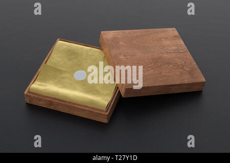 Flat open dark wooden square box with golden wrapping paper on black background. 3d illustration - Stock Photo
