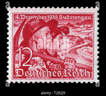 German historical stamp: Plebiscite on the accession of the Sudetenland. Couple. Miner with a pick and a woman peasant, 12+8 pf, issue 1938, Germany - Stock Photo
