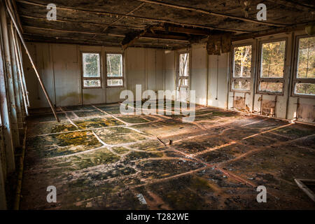Devastated room in an abandoned building - Stock Photo