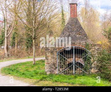 Antique, old stony stove with fireplace located in Bavarian Town in Germany. - Stock Photo