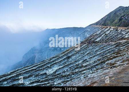 View of the Kawah Ijen volcano with toxic gases emerging from the bottom of the crater. Java, Indonesia. - Stock Photo