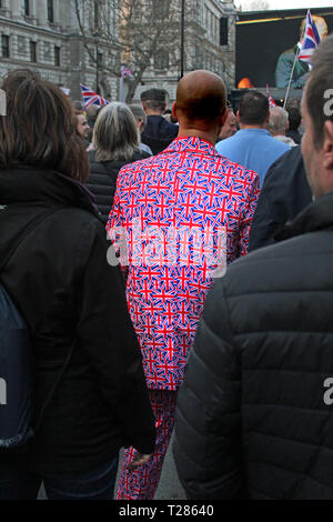 Man dressed in a Union Jack suit at the pro Brexit demonstration in Westminster, London - March 2019 - Stock Photo