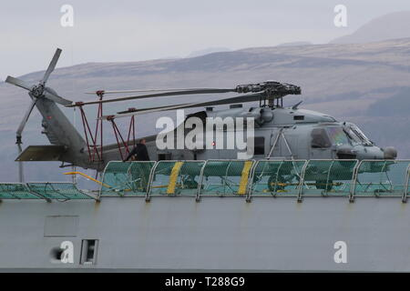 N-976, a Sikorsky MH-60R Seahawk operated by the Royal Danish Navy, on board KDM Absalon on arrival during Exercise Joint Warrior 19-1. - Stock Photo