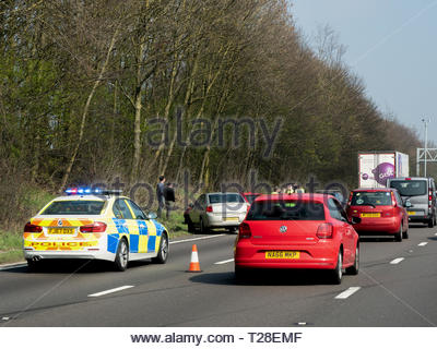 Motorway Police attend a rod traffic accident between two cars and a lorry. There were no serious injuries or deaths at the scene of this incident. - Stock Photo