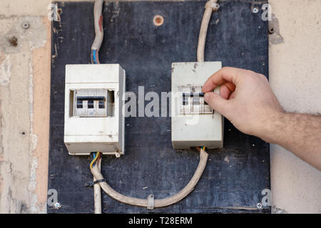 Electrician check or Inspect Electrical System circuit Breaker on Power Distribution panel. - Stock Photo