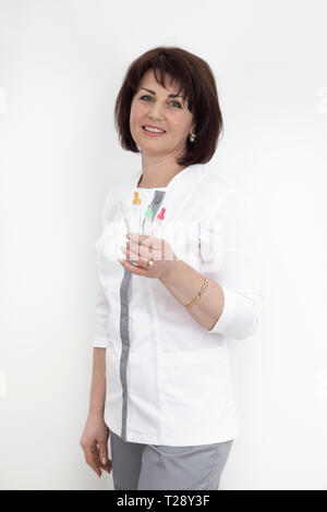Portrait of a female doctor with empty beakers for blood testing. photo on white background - Stock Photo