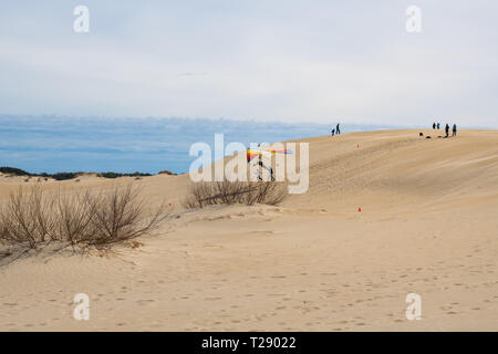 Hang gliding school on the dunes of Jockey's Ridge State Park in the Outer Banks of North Carolina - Stock Photo