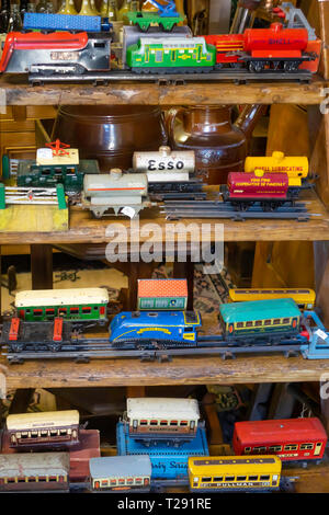 Interior of Eskdale Antiques a rural antique shop showing a collection of O gauge model railway tinplate rolling stock - Stock Photo