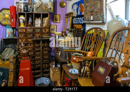 Interior of Eskdale Antiques a rural antique shop with a collection of old country farm and kitchenware - Stock Photo