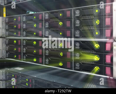 Big HDD Server Rack. Many powerful servers running in the data center server room. Disk storage array. - Stock Photo