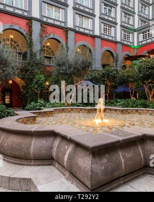 Interior garden fountain of the beautiful Four Seasons in Mexico City, Mexico - Stock Photo