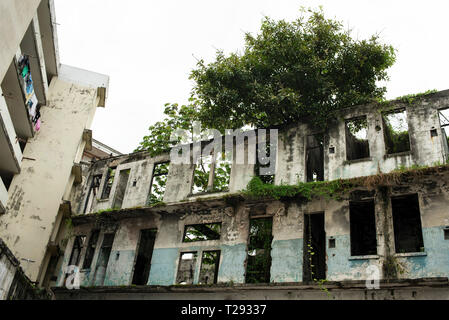 Derelict building next to a residential house. Photo taken from a courtyard in Casco Viejo, the historic town of Panama City, Panama. Oct 2018 - Stock Photo