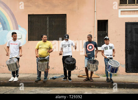 Young musicians rehearsing percussion with surdos (marching snare drum) on Sunday afternoon in downtown Panama City. Panama, Central America. Oct 2018 - Stock Photo