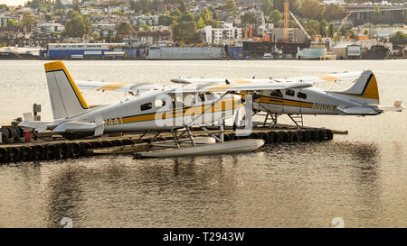 SEATTLE WA, USA - JUNE 2018: Floatplanes operated by Kenmore Air at the jetty of the seaplane terminal in Seattle at dawn. - Stock Photo