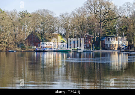 Berlin, Germany - February 9, 2018: Island Scharfenberg  in Tegeler See with a boarding school and a car ferry connecting the island with the mainland - Stock Photo