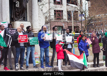 Manchester, UK. 31st Mar, 2019. Manchester, UK.  31st March 2019. Protestors in Manchester's Piccadilly Gardens stage a demonstration opposing Sudan's President Omar-al-Bashir, calling for him to submit to the International Criminal Court (ICC) for crimes allegedly committed in Darfur region. Sudan denies any atrocities and says it does not recognise the ICC. President Bashir,who took power in a 1989  military coup, has defied opposition calls to step down in the face of economic hardship in Sudan. Credit: JY News Images/Alamy Live News - Stock Photo