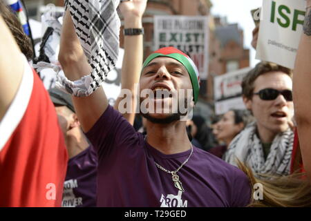 A protester is seen chanting slogans during the Exist, Resist, Return Rally for Palestine in London. People gather outside the Israeli embassy in London to demonstrate against the Israeli government, and to demand respect for Palestinians' fundamental rights to exist, resist and return. Palestinians are calling for global protests to support their right to come back to their villages. Rally was organized by Palestine Solidarity Campaign, Stop the War Coalition, Palestinian Forum in Britain, Friends of Al- Aqsa, and Muslim Association of Britain. - Stock Photo
