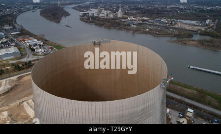 26 March 2019, Rhineland-Palatinate, Mülheim-Kärlich: The aerial photograph with a drone shows the cooling tower of the Mülheim-Kärlich nuclear power plant, once 162 metres high, on which around 50 metres have already been removed with the aid of a special remote-controlled machine. The demolition of the milestone Mülheim-Kärlich has been underway since 2004 - and according to planning it will take almost ten years. (Zu dpa: Landmarks disappear - nuclear power plant demolition in Mülheim-Kärlich and Biblis). Photo: Thomas Frey/dpa - Stock Photo